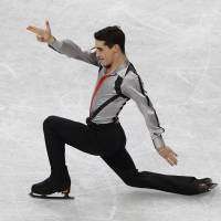 Here to contend: Spain's Javier Fernandez earns the bronze medal in the men's competition at the World Figure Skating Championships on Friday.   REUTERS