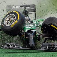 Kobayashi cleared after Australian GP crash