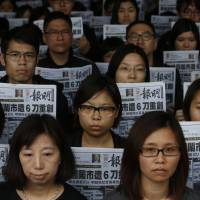 Hundreds in Hong Kong protest meat cleaver attack on journalist