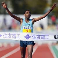 Ahead of the pack: Ethiopia's Bazu Worku crosses the line at Ojiyama Stadium to win the Lake Biwa Marathon on Sunday. | KYODO