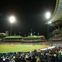 Whole new ball game: Fans watch the opening game of the MLB season between the Los Angeles Dodgers and the Arizona Diamondbacks at the Sydney Cricket Ground on Saturday night.   KYODO/GETTY