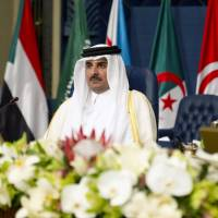 Raising Middle East tensions, Qatar's emir criticizes Egypt, Iraq