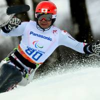 Winning form: Takeshi Suzuki competes in the men's sit-ski slalom event at the Sochi Paralympics at the Rosa Khutor Alpine Center on Thursday. | AFP-JIJI