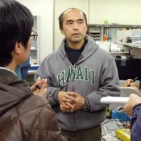 University of Yamanashi professor Teruhiko Wakayama, who has urged his co-authors on a groundbreaking stem cell study to have it retracted, addresses reporters on Monday. | KYODO