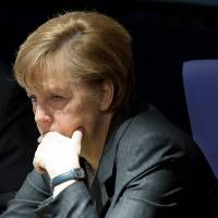 Ukraine mobilizes as Merkel warns Russia of long-term damage