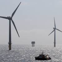 There it blows: Wind turbines protrude from the sea near Borkum Island, Germany. | AFP-JIJI