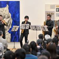 Saxophonist Masataka Hirano (left) gives a concert with other musicians at the Ueno Royal Museum in 2013. | SATOSHI AOYAGI