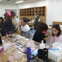 Artful fun: Makeup artists paint children's faces at the Akashi Lifelong Learning Center during Akashi Artful Week.