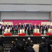 Participants in a previous Niigata Sakenojin make a toast to the crowd at the event.