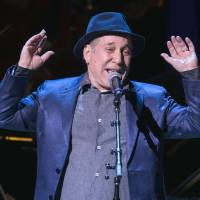 Singer Paul Simon performs earlier this month during the Rainforest Fund's 25th anniversary benefit concert in New York. Simon and his wife, Edie Brickell, were arrested and charged with disorderly conduct on April 26 after an apparent domestic dispute. | REUTERS