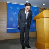 South Korean Prime Minister Chung Hong-won bows Sunday after announcing his resignation at a news conference in Seoul. Chung announced his resignation  over the government's poor response to the April 16 Sewol ferry disaster, in which it was first announced that everyone had been rescued.