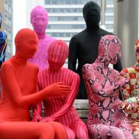 Members of the Tokyo Zentai Club meet at a park in Tokyo. Like just any group, they meet up every other month to hold barbecues or parties. Unlike any other group, they are covered head-to-toe in skintight Lycra. | AFP-JIJI
