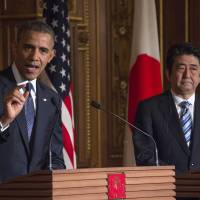 U.S. President Barack Obama speaks as Prime Minister Shinzo Abe looks on during a bilateral press conference held Thursday at the Akasaka Palace in Tokyo. | AFP-JIJI