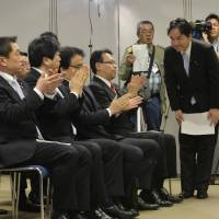 Keiichiro Asao bows in gratitude after members of the minor opposition force Your Party formally endorse him as the new leader at an all-party meeting Friday in Tokyo. Asao replaced his scandal-ridden predecessor, founder Yoshimi Watanabe. | KYODO
