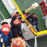 This screen grab from a video released by the South Korean Coast Guard on Monday shows Lee Joon-seok, the trouserless captain of the ferry Sewol, being rescued on April 16. | AFP-JIJI