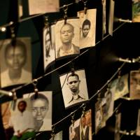 Photographs of people who died in the 1994 Rwandan genocide are displayed Saturday at the Kigali Genocide Memorial Center in the country's capital, Kigali. Rwanda will mark the 20th anniversary of the atrocity, which left up to 1 million dead, on Monday. | AP