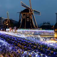 Huis Ten Bosch, a Dutch-themed park in Sasebo, Nagasaki Prefecture, is illuminated in November. | KYODO
