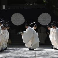Priests at Yasukuni Shrine in Tokyo prepare for its annual spring festival Tuesday. | REUTERS
