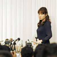 Riken institute researcher Haruko Obokata prepares to defend her discovery of STAP cells in Osaka on Wednesday. | KYODO