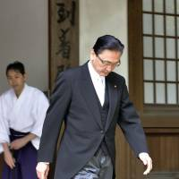 Keiji Furuya, state minister in charge of the abduction issue, leaves Yasukuni Shrine in Tokyo on Sunday. | KYODO