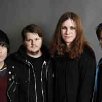 Singing the blues: Inge Johansson, James Bowman, Laura Jane Grace and Atom Willard make up punk quartet Against Me! The band's new album, 'Transgender Dysphoria Blues,' is about a transgender prostitute. | AP