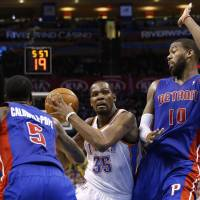 Scoring champ: Oklahoma City's Kevin Durant drives on Detroit's Kentavious Caldwell-Pope in the fourth quarter on Wednesday night. The Thunder edged the Pistons 112-111. | AP