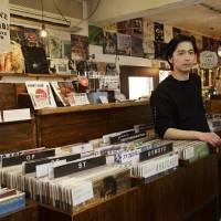 Vinyl revival: Big Love Records owner Masashi Naka gets his shop ready ahead of Record Store Day. The shop is one of many to feature in-store performances to celebrate the event, which has become a popular yearly tradition overseas. | CHIEKO KATO