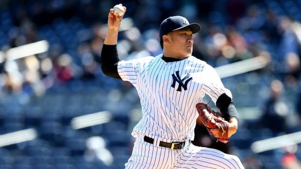Tanaka sizzles on frigid day as Yanks sweep Cubs in DH