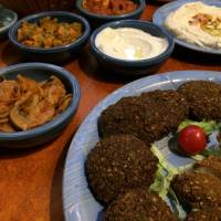 Milk and honey: The all-you-can-eat dinner at Shamaim includes Israeli staples hummus, falafel and chicken schnitzel. | REBECCA MILNER