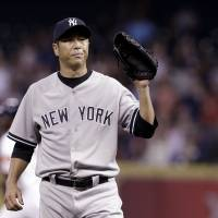 Disappointing start: New York starting pitcher Hiroki Kuroda waits for the ball after giving up a home run to Dexter Fowler in the first inning of the Yankees' 3-1 loss to the Astros on Wednesday. | AP