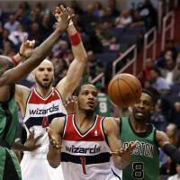 Wizards wrap up playoff berth with win over Celtics