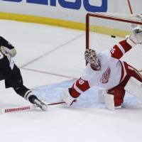 Letang helps Pens prevail