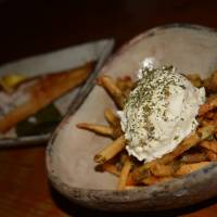 Eat more chips: Fries are not the only dish at Gohanya Isshin, but they certainly are to die for, coated with pesto and topped with cream cheese. | JJ O'DONOGHUE
