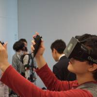 Brave new world: Curious game fans got a glimpse of the future at OcuFes, an Osaka event dedicated to Oculus Rift, which is a virtual-reality headset newly acquired by Facebook.  | ADAM MILLER