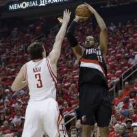 On fire: Portland's LaMarcus Aldridge puts up a jumper over Houston's Omer Asik in Game 2 on Wednesday night. | AP