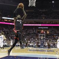 Swoop to the hoop: Miami's LeBron James soars for a dunk against Charlotte in the first half of Game 4 on Monday. | AP