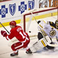 Moment of truth: Detroit's Gustav Nyquist scores the game-winning goal against Boston goalie Tuukka Rask in the Red Wings' 3-2 victory on Wednesday. | AP
