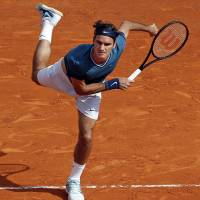 Impressive victory: Roger Federer serves to Novak Djokovic during their semifinal match at the Monte Carlo Masters on Saturday. Federer won 7-5, 6-2. | REUTERS