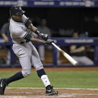 Going deep: New York's Alfonso Soriano blasts a solo homer against Tampa Bay in the fifth inning on Thursday night. | AP