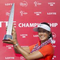 Drought ends: Michelle Wie shows off her trophy after winning the LPGA Lotte Championship in Kapolei, Hawaii, on Saturday. Wie carded a final-round 67 and won by two strokes. | AP