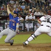 Safe at home: The Mets' David Wright scores as Arizona's Miguel Montero can't handle the throw in the fifth inning on Monday. | AP