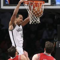 Nets beat Rockets to reach playoffs