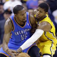 Defensive minded: The Pacers' Paul George (right) defends against Thunder forward Kevin Durant on Sunday. | AP