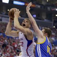 Griffin, Clippers crush Warriors to even series