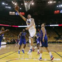 Easy deuce: Golden State's Klay Thompson scores against Los Angeles in the first half of Game 3 on Thursday night. | AP