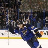 I got this: Blues defenseman Kevin Shattenkirk raises his stick in celebration after scoring the decisive goal in the shootout against the Flyers on Tuesday in St. Louis. | AP