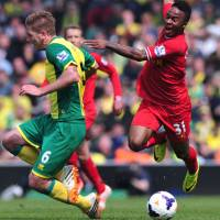 Dare to dream: Liverpool's Raheem Sterling (right) competes with Norwich's Michael Turner at Carrow Road on Sunday. | AFP-JIJI