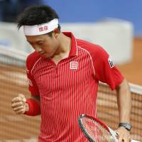 No pain in Spain: Kei Nishikori celebrates during his win over Roberto Bautista Agut on Tuesday. | KYODO