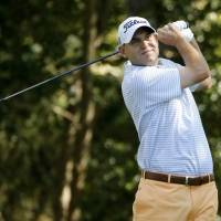 Haas grabs lead at Masters