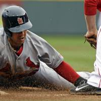 Cardinal rule: St. Louis' Jon Jay is tagged out by Cincinnati's Todd Frazier during the Cardinals' 7-6 win on Thursday. | AP